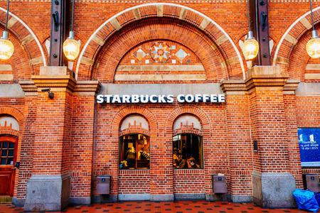 starbucks coffee: COPENHAGEN, DENMARK - JANUARY 3, 2015: Starbucks coffee shop at Copenhagen Central railway Stationin Denmark.