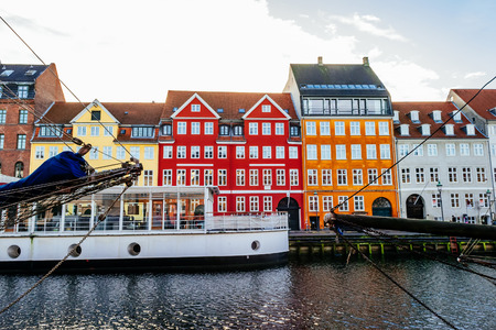 Nyhavn district is one of the most famous landmarks in Copenhagen with typical colorful houses 版權商用圖片
