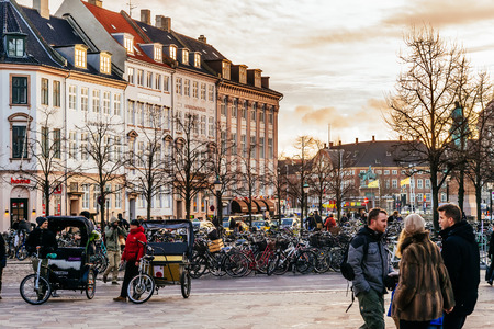 COPENHAGEN, DENMARK - JANUARY 3, 2015: Stroget is a pedestrian, car free area in Copenhagen, Denmark. Popular tourist attraction in town centre is one of longest pedestrian shopping streets in Europe.