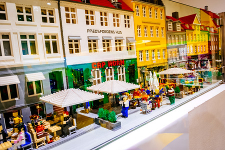 COPENHAGEN, DENMARK - JANUARY 3, 2015: Lego figurines and forms the Lego store showing Nyhavn neighborhood in Copenhagen, Denmark.