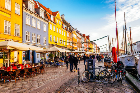COPENHAGEN, DENMARK - JANUARY 3, 2015: Nyhavn district is one of the most famous landmarks in Copenhagen with typical colorful houses and water canals. Editorial