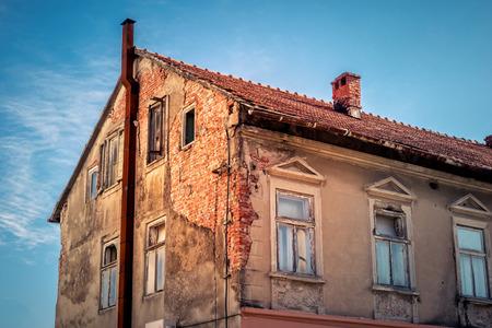 decrepit: Decrepit facade of the old brick house