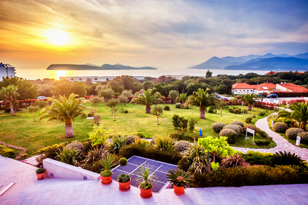 landscaped garden: View of the landscaped garden in Dubrovnik and the sunset over the Adriatic Sea in front Stock Photo