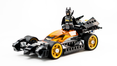 ZAGREB, CROATIA - DECEMBER 25, 2015: Lego toy Batman with Batmobile. Studio shot on white background. Editorial