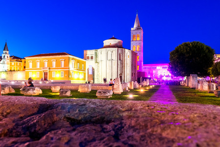 building monumental: ZADAR, CROATIA - JULY 28, 2015: Church of st. Donat, a monumental building from the 9th century lit by warm lights on summer night in Zadar, Croatia