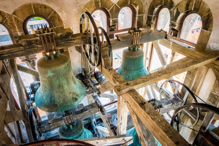 ZADAR, CROATIA - JULY 28, 2015: Interior of the bell tower and the bells of the church of St. Anastasia in Zadar, Croatia 에디토리얼