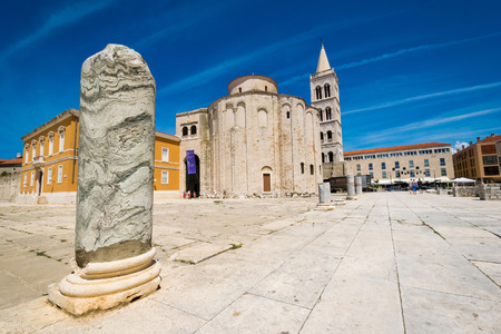 ZADAR, CROATIA - JULY 28, 2015: Church of st. Donat, a monumental building from the 9th century with historic roman artefacts in foreground in Zadar, Croatia