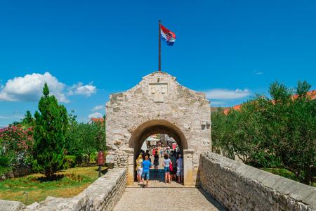 croatian: NIN, CROATIA - JULY 30, 2015: Entrance gate to the historic city of Nin, Croatia