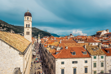 DUBROVNIK, CROATIA - JUNE 13, 2016: Multitude of tourists visit the Old City of Dubrovnik and the famous street Stradun Editorial
