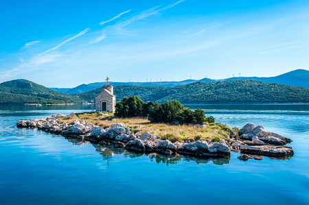 small island with a very old lighthouse located in southern Croatia, Dalmatia Stock Photo