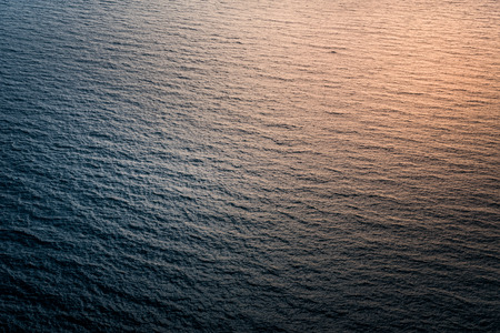 Unusual and abstract reflections of sunlight on the surface of sea