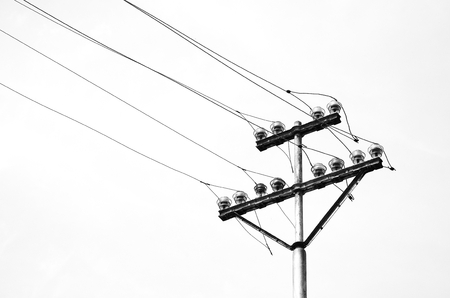electricity pole: old electricity or telegraph pole, white wire and cables