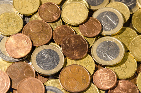 earing: a group of euro and cent coins Stock Photo