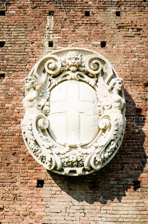 townhall: coat-of-arms of milan, sculpture from renaissaince. symbol of the townhall