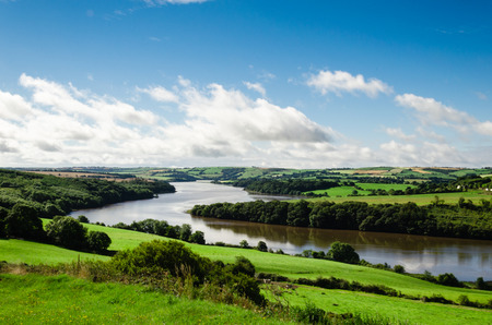 river county: landscape with a river and hill, Cork county, Ireland Stock Photo
