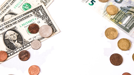 opposing: euro and dollars lay opposing over white and the silhouettes of the uniteed states and european union, s symbol for whealth, gain and commerce across states. over white Stock Photo