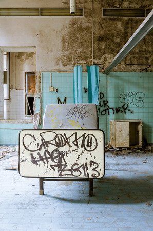 forniture: view of a abandoned hospital, with ruin and damaged furniture and bed