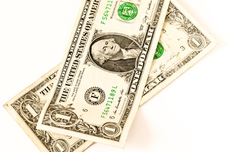 two us dollar: two usa dollars lay over white, business symbol for whealth and gain, over white Stock Photo
