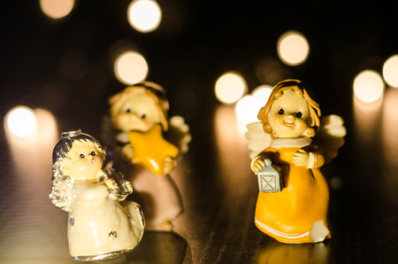 yelllow: a group of three little angels , symbol of christmas