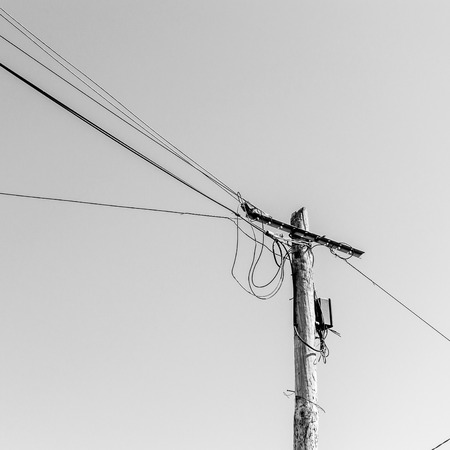 telegrama: view of an old woodden electric pole with wires Foto de archivo