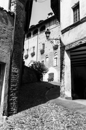 saluzzo: street view of an italian old town, saluzzo, italy