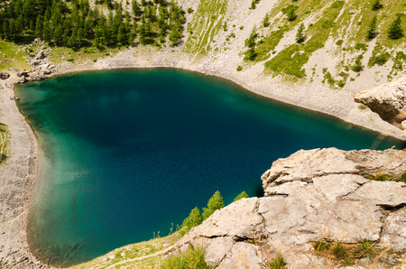 aereal: aereal view of the black lake, a glacial lake on the alps sorrounding the Maira Valley, close to Turin Stock Photo