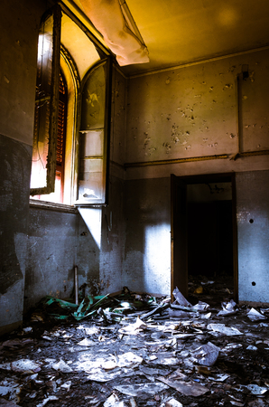 forniture: view of a abandoned hospital, with ruin and damaged furniture Stock Photo