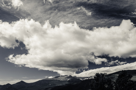 overhang: scenic view of clouds that overhang the rocky mountains, colorado, usa black and white
