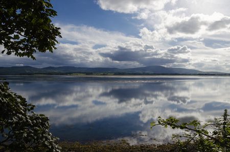 view of a bay close to sligo (ireland) at sunset after a raining day Stock Photo