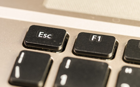 esc: close up of a  personal computer keyboard, with esc command