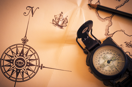 still life with a compass and over an old map. travel. vintage. direction