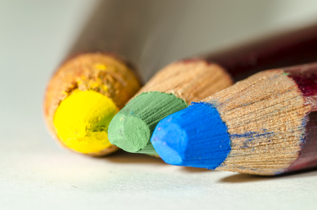 grouped: green, blue, yellow coloured pencil grouped together