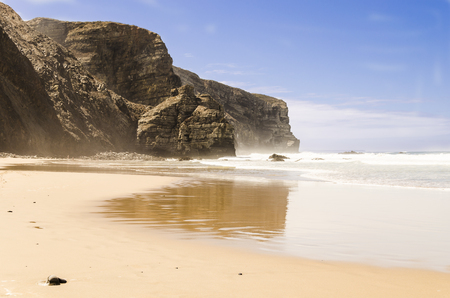 view of a beach in algarve with reflection of the cliffs. algarve , portugal Stock Photo