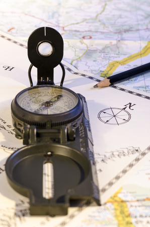 stille life with compass over an old and new map. travel. route. direction.
