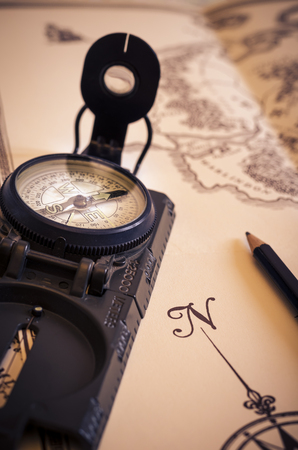 view of a compass over an old map. travel. vintage. direction