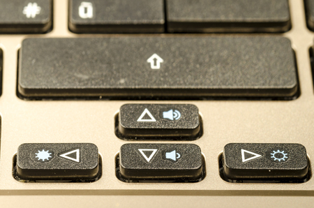 close up of a  personal computer keyboard, with arrow command
