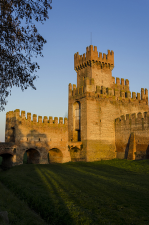 view of the external wall of a castle with a tower Stock Photo