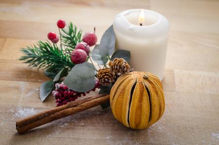 still life of few symbols of christmas. panettone, tangerine, cinnamon, candle.