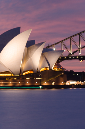 panoramic view of the Sydney bay during sunset, with the opera house and iron bridge. australia. travel.