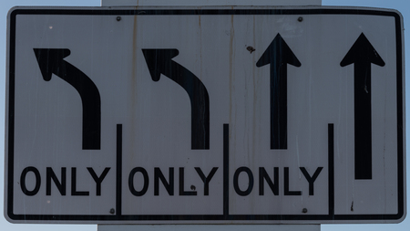 View of a street sign with the arrow to indicate only one way to go. Decision, freedom.