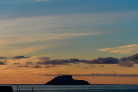 view of a small isalnd in front of angra do heroismo during sunrise. azores, portugal