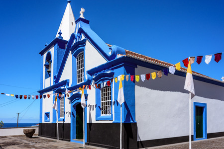 decorated facade of a church in azores with the traditional blue and white colors. portugal