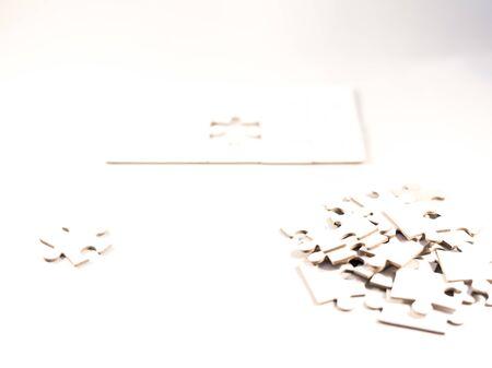 white jigsawpuzzle whit one gap, symbol of problem solving