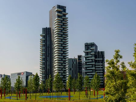 with of the new Milan skyline from the park Imagens