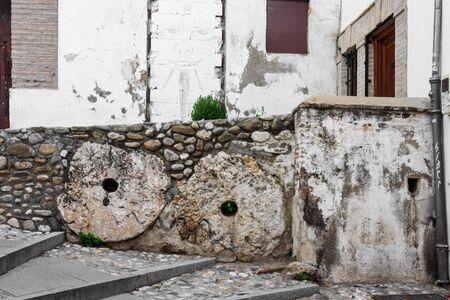 view of a narrow street in albaici, the arab quarter in granada. spain Imagens