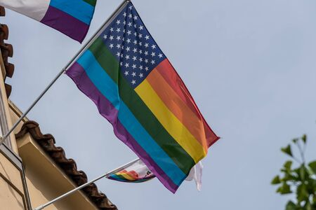 view of a united states flag with rainbown stripes. symbol of lgbt comunity.