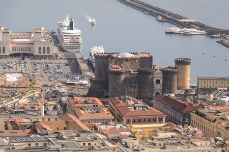 aereal view of the Maschio Angioino (Naples castle) in front of the harbor, Naples. Italy