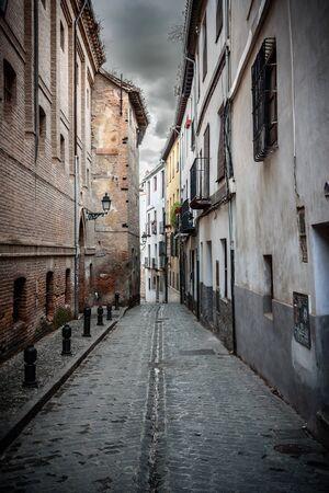 view of a narrow street in albaicin, the arab quarter in granada. spain