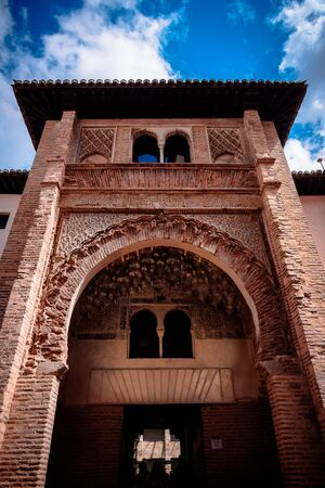 view of the entrance of the corral the carbon an arad palace in the city center of granada, spain. Imagens