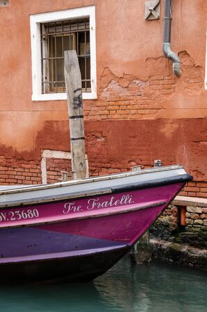 details of a boat anchored in a canal in venice, italy
